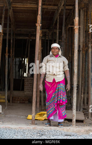 PUDUCHERY, PONDICHERY, TAMIL NADU, INDIA - March circa, 2018. Portrait of unidentified woman smiling workers are employed in construction work to buil - Stock Photo