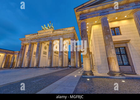 The famous illuminated Brandenburg Gate in Berlin, Germany, at night - Stock Photo