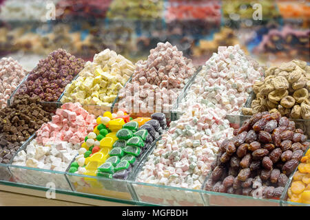 Turkish traditional sweets, rahat lukum, figs, dates and tea in counter in the Grand Bazar market, Istanbul - Stock Photo