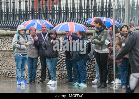 London UK. 28th April 2018. Tourists and pedestrians  shelter from the rain and soggy conditions outside in Charing Cross  on another wet day in London Credit: amer ghazzal/Alamy Live News - Stock Photo