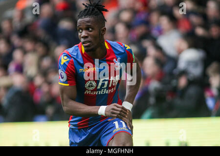 London, UK, 28 April 2018. Wilfried Zaha of Crystal Palace looks on.  Premier League match, Crystal Palace v Leicester City at Selhurst Park in London on Saturday 28th April 2018.  this image may only be used for Editorial purposes. Editorial use only, license required for commercial use. No use in betting, games or a single club/league/player publications. pic by Kieran Clarke/Andrew Orchard sports photography/Alamy Live news - Stock Photo
