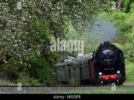 27 April 2018, Germany, Trier: A steam train travelling with guests on the route from Gerolstein to Trier. From the 28 April to the 01 May 2018, historical steam, diesel and E-locomotives with carriages in Rhineland-Palatinate, Saarland and Luxembourg are taking visitors on a special time travel. Photo: Harald Tittel/dpa - Stock Photo