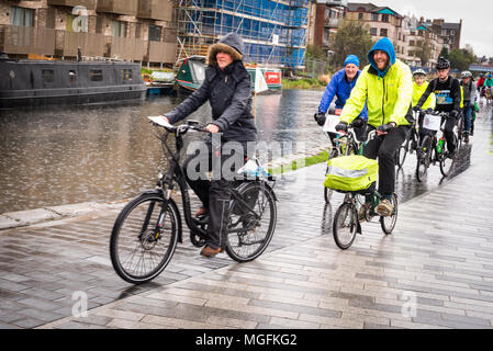 Edinburgh, UK. 28 April 2018. Cyclists and walkers take part in the rainy Pedal on Parliament protest march from The Meadows to the Scottish Parliament in Holyrood, Edinburgh. It was led by Mark Beaumont, the record-breaking long-distance British cyclist and adventurer. The event is organised to ask all of Scotland's politicians, from all parties, to sign up to a manifesto to make Scotland a cycle friendly country for people of all ages and abilities. Credit: Andy Catlin/Alamy Live News - Stock Photo