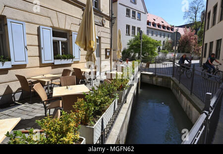 27 April 2018, Germany, Augsburg: A canal with water from the Lechs flowing through the old town. The city of Augsburg has applied as 'Wasserbau und Wasserkraft, Trinkwasser und Brunnenkunst in Augsburg' (lit. hydarulic engineering, hydropower, drinking water and fountain art) for admission to the UNESCO world heritage list. Photo: Karl-Josef Hildenbrand/dpa - Stock Photo