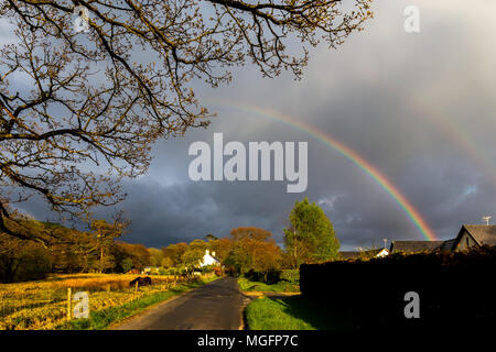 Pontrhydfendigaid, Ceredigion, Wales, UK 28th April 2018 UK Weather: After a nice calm day a beautiful rainbow appears over Pontrhydfendigaid during a short spell of rain this evening. © Ian Jones/Alamy Live News. - Stock Photo