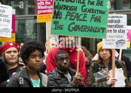 London UK 28th April 2018  People gather to protest at the Home Office in central London after it emerged that a number of Windrush generation migrants, who arrived in the UK from 1948-71, have been threatened with deportation by the Home Office. Credit: Thabo Jaiyesimi/Alamy Live News - Stock Photo