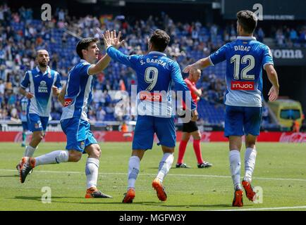 Barcelona, Spain. 28th Apr, 2018. RCD Espanyol's Gerard Moreno (2nd L) celebrates with Sergio Garcia (2nd R) during a Spanish league match between RCD Espanyol and Las Palmas in Barcelona, Spain, on April 28, 2018. The match ended 1-1. Credit: Joan Gosa/Xinhua/Alamy Live News - Stock Photo