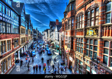 City of Chester, England. Artistic view of shoppers on Chester's Eastgate Street. The scene was captured from the Eastgate section of the City Wall. - Stock Photo