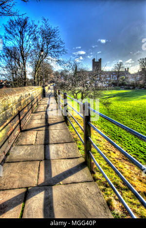 City of Chester, England. Artistic silhouetted view of Chester City Walls, with the north façade of Chester Cathedral in the background. - Stock Photo