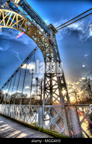 City of Chester, England. Artistic silhouetted view of the Queens Park Suspension Bridge over the River Dee. - Stock Photo