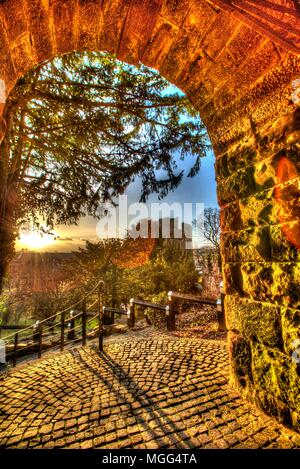 City of Chester, England. Artistic view of the arch and steps leading from Water Tower Gardens to Bonewaldesthorne's Tower and Chester City Walls. - Stock Photo