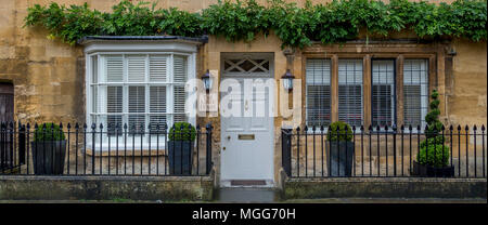 Cotswold limestone adorns the facade of this elegant double fronted terraced house in the picturesque market town high street of Chipping Campden - Stock Photo
