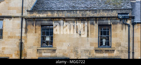 Cotswold limestone adorns the facade of this elegant terraced house in the picturesque market town high street of Chipping Campden - Stock Photo