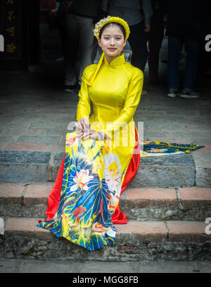 lovely young Vietnamese woman in the Ao Dai, the traditional dress - Stock Photo