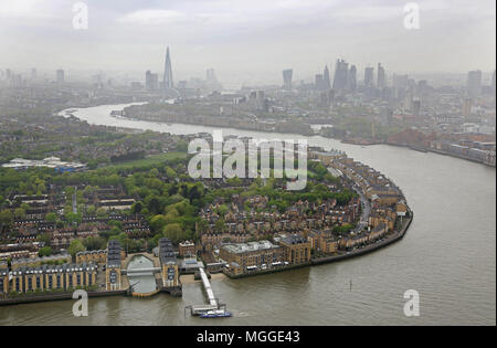 High level view of the River Thames from Canary Wharf looking towards the City of London. Overcast April morning. Shows Rotherhithe in foreground. - Stock Photo
