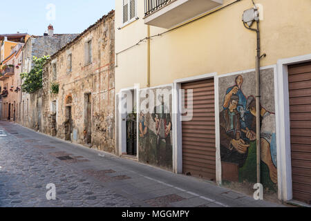 Murales in Orgosolo Italy Since about 1969 the wall paintings reflect different aspects of Sardinia's political struggles and international issues - Stock Photo
