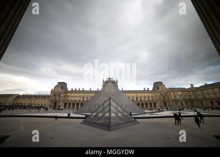 The Louvre Palace and Museums (Glass pyramid's outside La Louvre, Paris) - Stock Photo