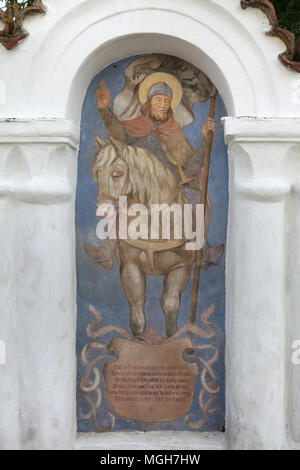 Saint Wenceslaus depicted in the mural painting in the funeral chapel at the village cemetery in Albrechtice nad Vltavou in South Bohemian Region, Czech Republic. Funeral chapels placed on the cemetery wall were decorated with murals in the 1840s by local painter František Mikule conducted with parish priest Vít Cíza, who also composed poems for each mural. The murals were repainted several times during the 19th and 20th centuries and completely restored by the team led by Jitka Musilová in 2010-2013. - Stock Photo