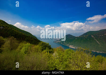 a beautiful view of Lugano and it's lake from the Belvedere, Lanzo d'Intelvi, Como, Italy, during Spring - Stock Photo