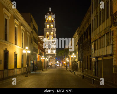 Puebla, Mexico, South America - January 2018: [Town of Puebla at night, street and church decorated with lights] - Stock Photo