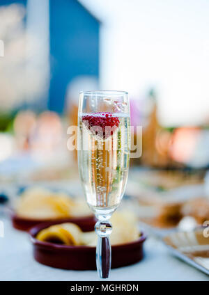 Close up a glass of champagne with strawberry