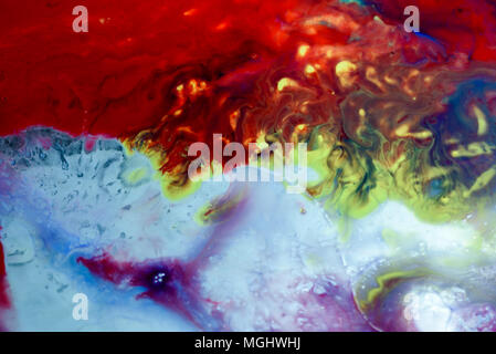 Abstract liquid milk flowing pattern like nebulae in the universe with different colours of white, blue, red and pink. Copy space area for space explo - Stock Photo