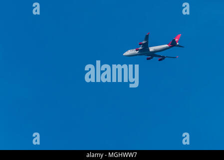 Virgin Atlantic jumbo jet Boeing 747 Big blue sky - Stock Photo