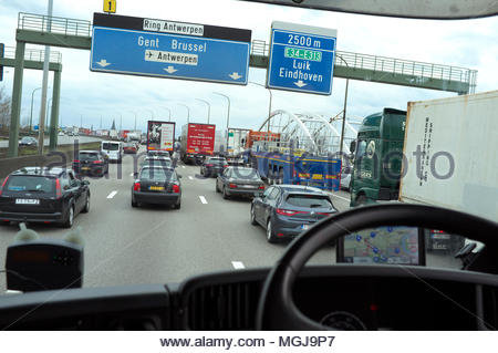Traffic congestion on the Antwerp ring road (R1), as seen from a UK right hand drive lorry. Antwerp, Belgium. - Stock Photo