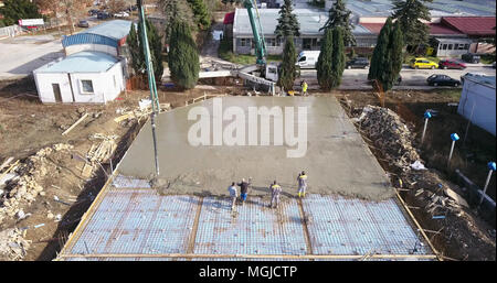 drone image, aerial wiev of a construction site during pouring cement, imag - Stock Photo