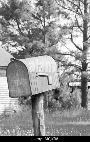 Vintage scene from days gone by. Drive the country roads and see rusted mailboxes, old gas pumps, and wooden buildings that housed long forgotten folk - Stock Photo