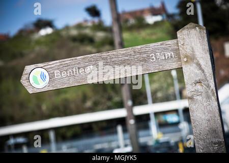 BENFLEET, UK – APRIL 3, 2017: closeup photo of a wooden sign pointing to Benfleet, Essex, UK - Stock Photo