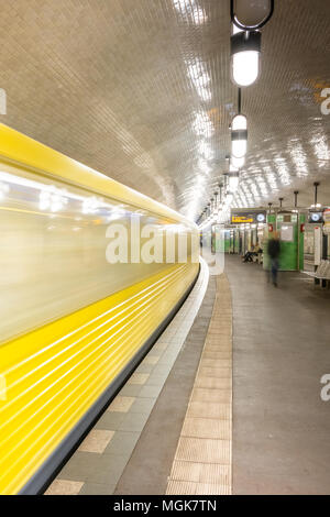 Early morning commuters depart one of the frequent metro (U-Bahn) trains at Märkisches Museum in the centre of the German capital of Berlin. - Stock Photo
