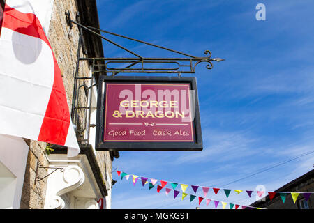 The George & Dragon hanging pub sign in the quaint village of Wray in Lancaster, Uk - Stock Photo