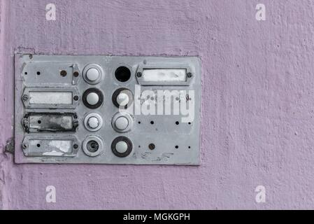 Worn doorbell with intercom on a house wall - Stock Photo