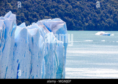The Perito Moreno glacier in Argentina ends with a high wall of ice before making place for Lago Argentino. - Stock Photo