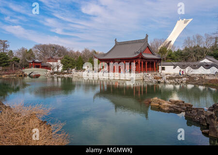Montreal, CA - 28 April 2018: Chinese Garden of the Montreal Botanical Garden, with Olympic stadium tower in background.
