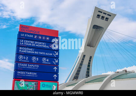 Montreal, CA - 28 April 2018: The Montreal Olympic Stadium and inclined tower. - Stock Photo