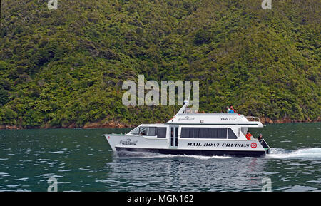 Picton, New Zealand - January 04, 2018: Cruising in The Marlborough Sounds on a mail boat catermeran. - Stock Photo