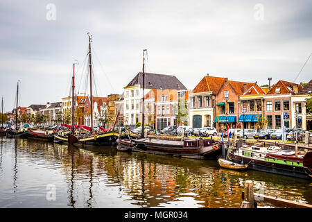 Traditional fishing boats moored along shore in Zwolle, the Netherlands - Stock Photo