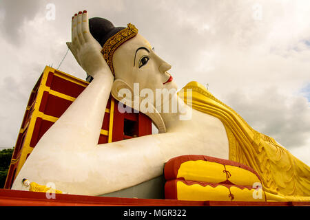 Giant Reclining Buddha at the Maha Bodhi Ta Htaung, a famous Buddhist region and monastery, Monywa Township, Sagaing Area, Myanmar (Burma) - Stock Photo