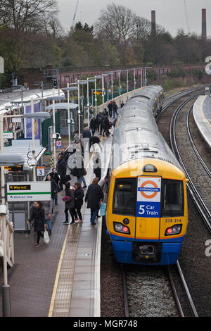 A London Overground class 378 capitalstar train at  West Brompton station on the west London line with passengers - Stock Photo