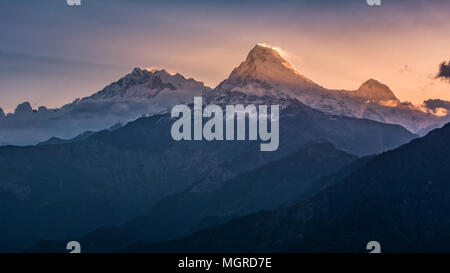 Annapurna mountain sunrise at Poonhill viewpoint. - Stock Photo
