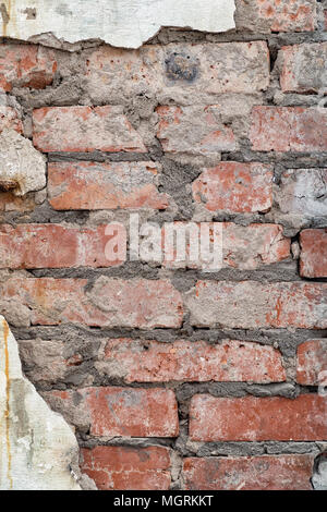Old red brick wall with plaster - Stock Photo