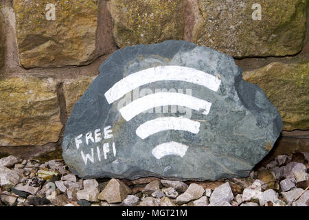 A free WiFi sign with signal bars on a piece of cut slate - Stock Photo