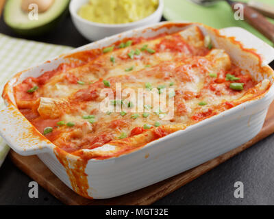 Three enchiladas in a baking dish - Stock Photo