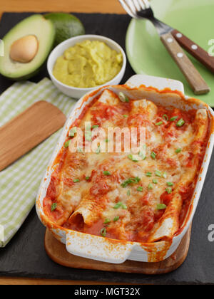 Three enchiladas in a baking dish - Stock Photo
