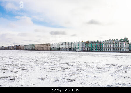 view of frozen Neva river and Dvortsovaya embankment in Saint Petersburg city in March - Stock Photo