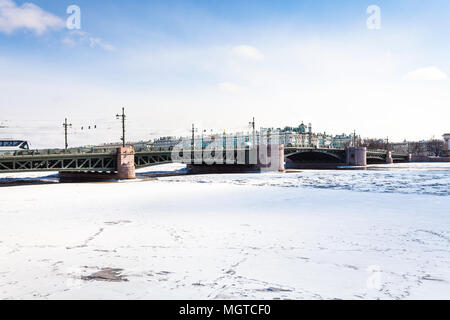 The Palace Bridge and frozen Neva river in Saint Petersburg city in March - Stock Photo