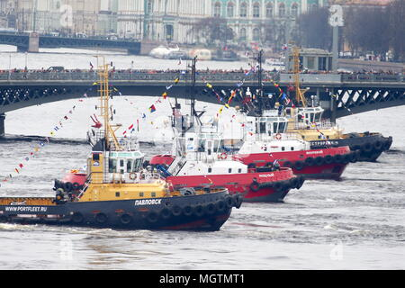 St Petersburg, Russia. 29th Apr, 2018. ST PETERSBURG, RUSSIA - APRIL 29, 2018: Tugboats waltz on the Neva River as part of the 5th Icebreaker festival. Peter Kovalev/TASS Credit: ITAR-TASS News Agency/Alamy Live News - Stock Photo