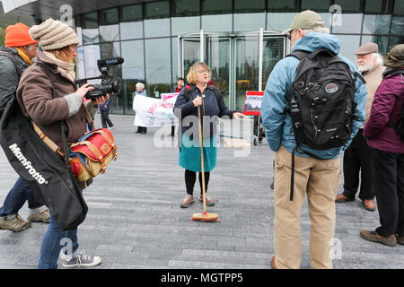 London, UK. 29 April 2018. A woman poses with a broom to symbolise the working class being swept away in London. Penelope Barritt/Alamy Live News - Stock Photo